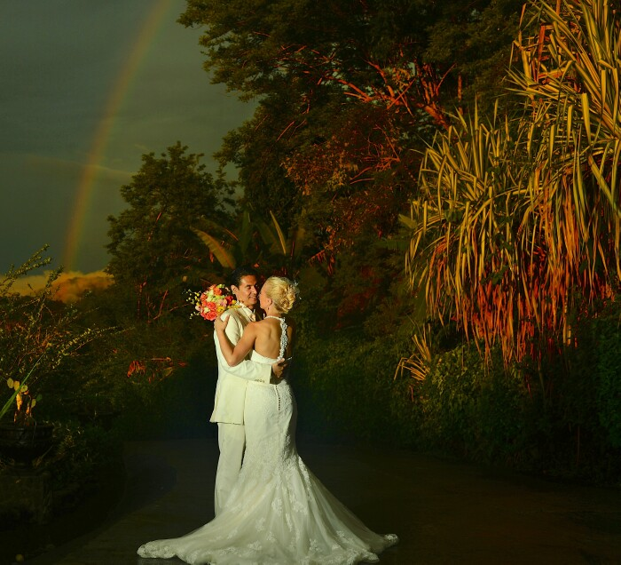 Wedding Couple under tropical rainbow in Costa Rica
