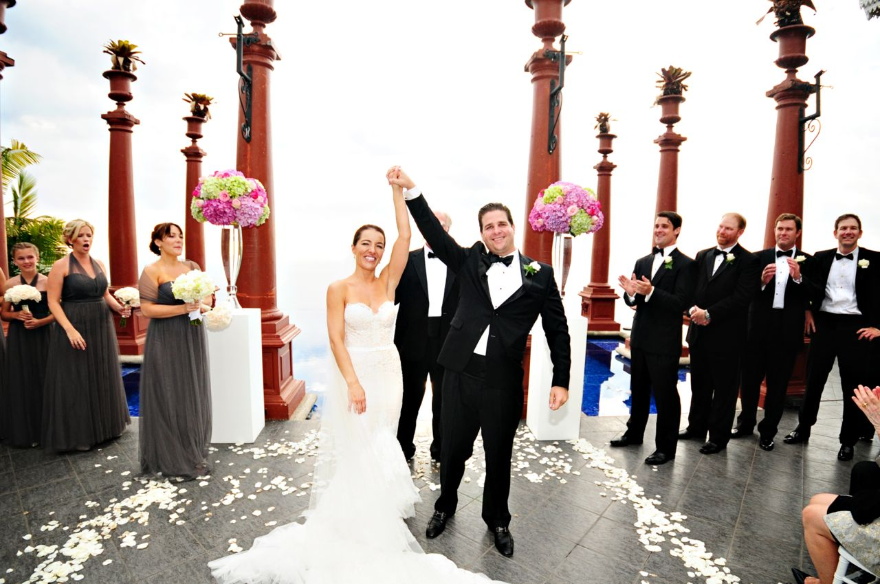 colorful ceremony at Zephyr Palace with bride and groom